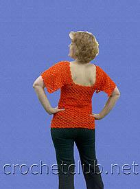 вязаная оранжевая кофточка