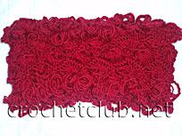 красный шарф связанный на вилке
